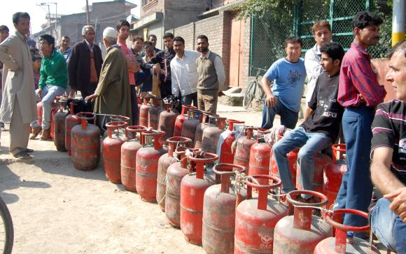 People wait in queue to get their LPG cylinders refilled