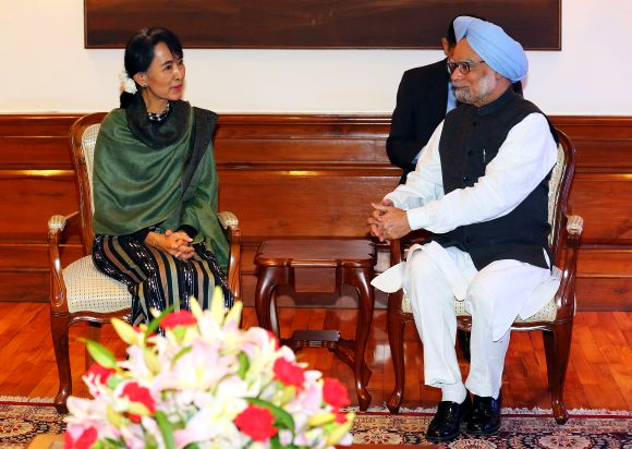 Aung San Suu Kyi speaks with Prime Minister Manmohan Singh during their meeting in New Delhi on Wednesday.