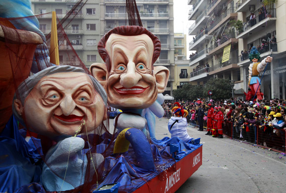 A carnival float depicting France's President Nicolas Sarkozy and former IMF chief Dominique Strauss-Kahn