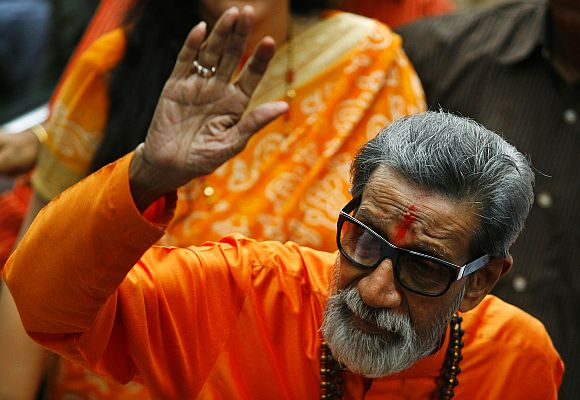 Thackeray, chief of Shiv Sena, waves towards the media as he arrives to cast his vote at a polling centre in Mumbai