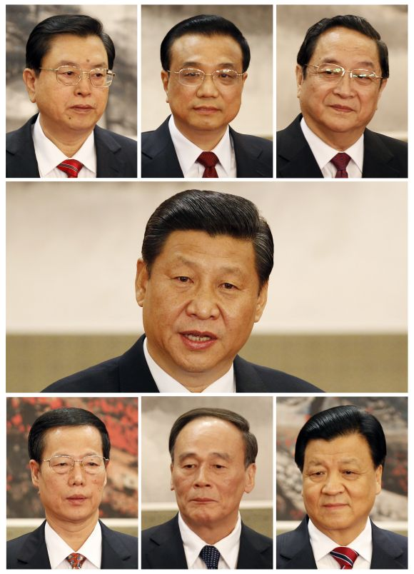 A combination picture shows China's new Politburo Standing Committee members, (1st row from L to R), Zhang Dejiang, Li Keqiang, Yu Zhengsheng, (2nd row) Xi Jinping, (3rd row from L to R) Zhang Gaoli, Wang Qishan, Liu Yunshan meeting with the press at the Great Hall of the People in Beijing.