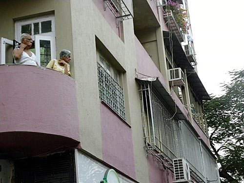 Residents of Colaba in south Mumbai watch as shops shut in the area