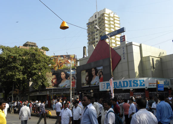 A bundle of flowers hangs above the street near Paradise cinema in Mahim to shower flowers on the cortege at a pull on the string