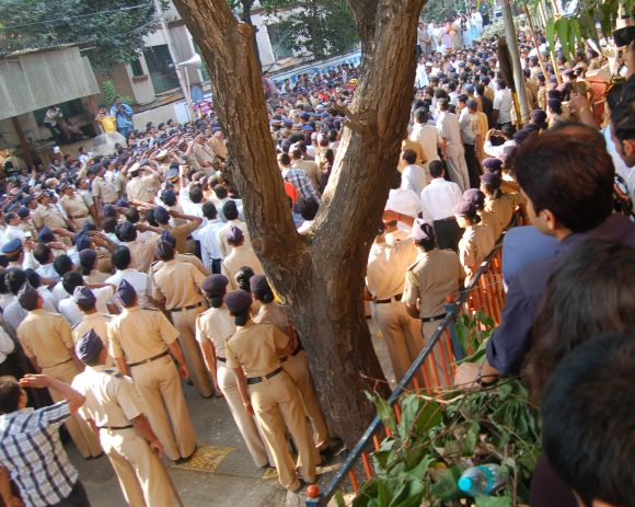 Cops saluting Bal Thackeray's body during the state funeral.