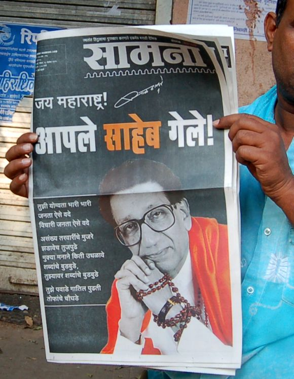 A cop reading the Shiv Sena mouthpiece 'Saamna'