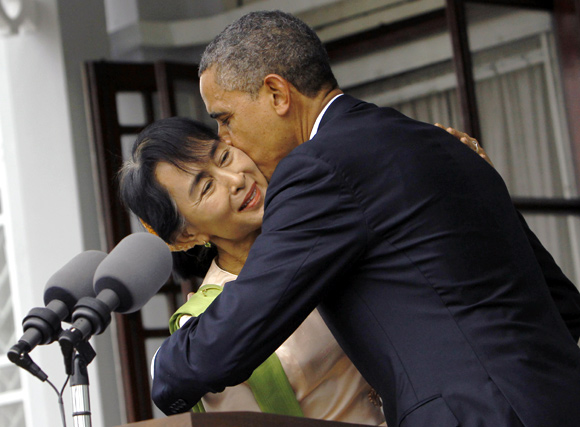 US President Barack Obama kisses Myanmar's opposition leader Aung San Suu Kyi after their meeting at her residence in Yangon