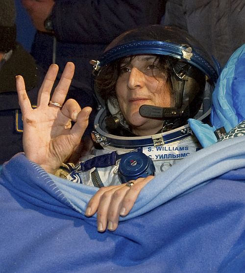 The International Space Station crew member US astronaut Sunita Williams gestures shortly after landing near the town of Arkalyk, in northern Kazakhstan