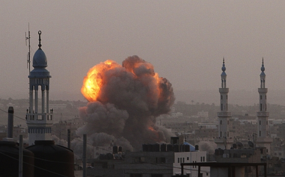 An explosion and smoke are seen after Israeli air strikes in Gaza
