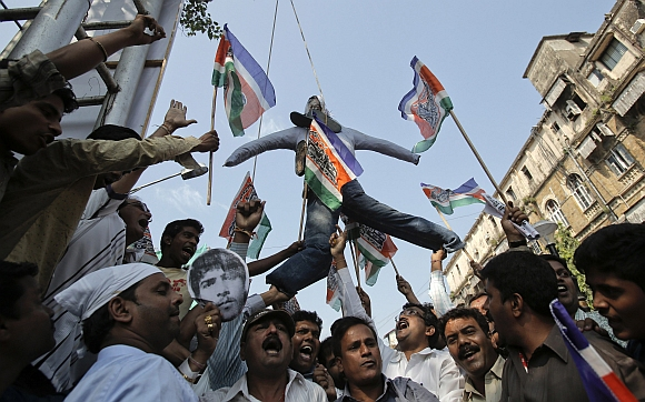 Supporters of the Maharashtra Navnirman Sena hang an effigy of Mohammad Ajmal Kasab outside Chhatrapati Shivaji Terminus train station, which was one of the targets of the 26/11 attacks, in Mumbai
