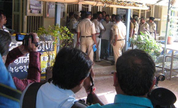 The 10 arrested men at the Palghar police station