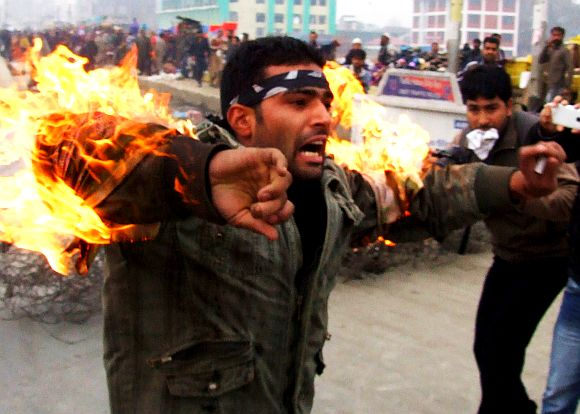 A person sets himself on fire protesting ban on Muharram processions in Srinagar on Friday
