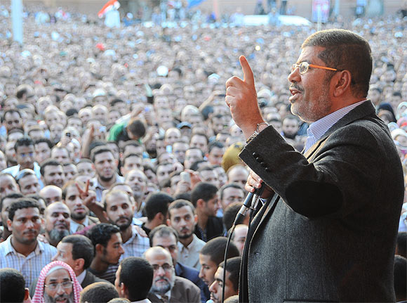 Egypt's President Mohamed Mursi speaks to supporters in front of the presidential palace