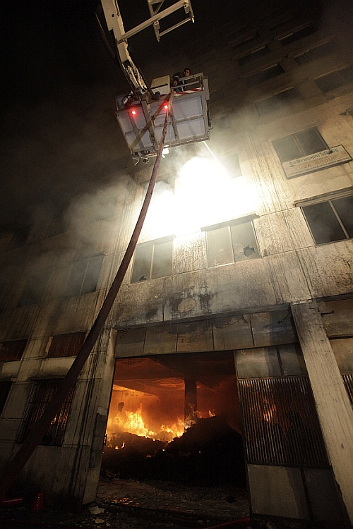 Firefighters try to control a fire in a garment factory in Savar, outskirts of Dhaka