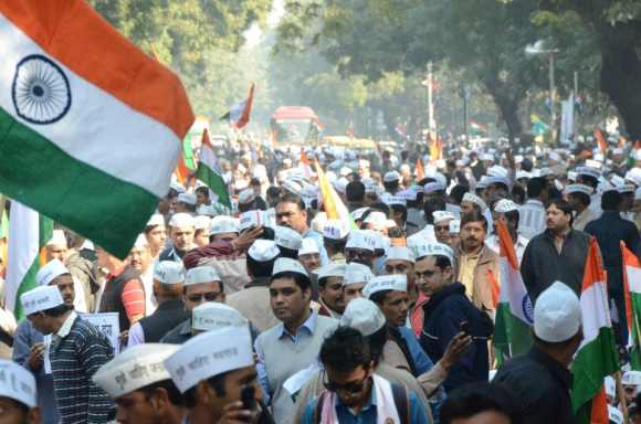 Supporters don the 'aam aadmi' caps as the participate in the rally