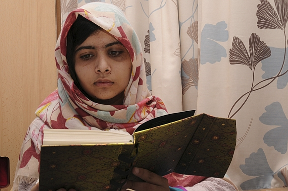 Pakistani schoolgirl Malala Yousufzai reads a book as she recuperates at the The Queen Elizabeth Hospital in Birmingham in this undated handout photograph