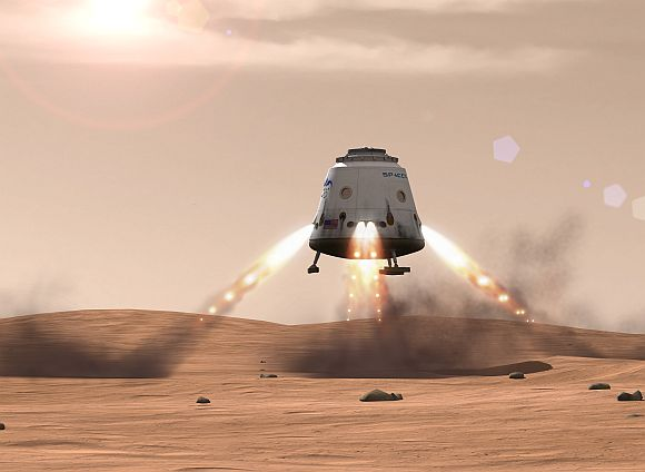 Artist's rendition of a Dragon spacecraft landing on the surface of Mars