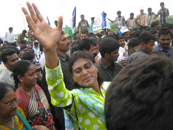 Sharmila waves to supporters during her visit to Telangana