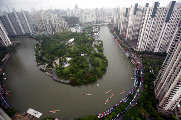 An aerial view shows boats participating in a dragon boat race on the Suzhou river in Shanghai