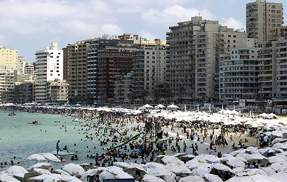 Egyptians crowd a public beach in Alexandria