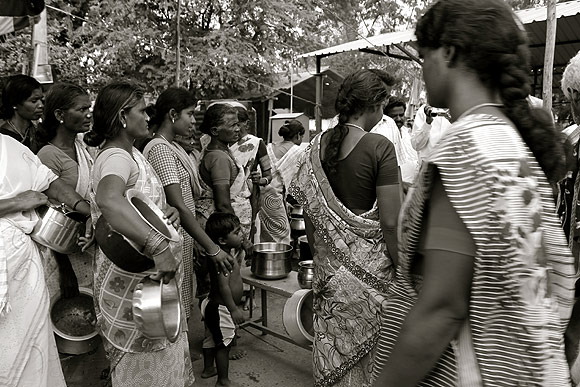 Two weeks after the atrocity, women queue up for lunch at the relief camp in Natham Colony, Dharmapuri