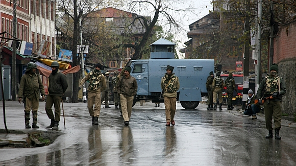 CRPF personnel partol the streets of Srinagar