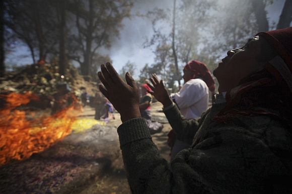 Indigenous Mayan prays during a ceremony