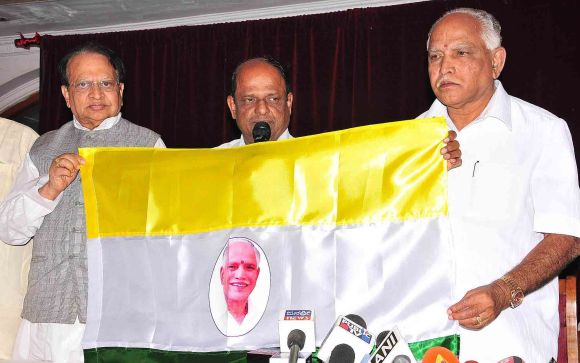 Yeddyurappa unveils the flag of his Karnataka Janata Party in Bangalore on Friday