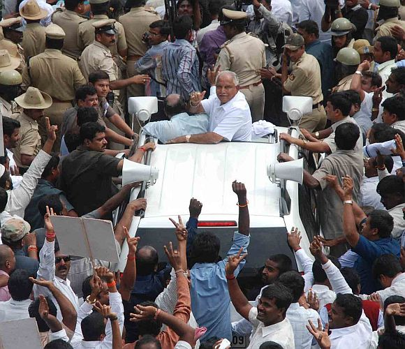 Yeddyurappa waves to cheering supporters in Bangalore on Friday
