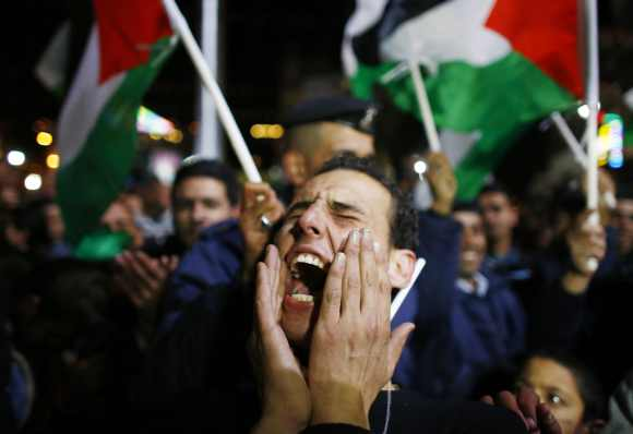 A Palestinian man shouts slogans during a rally in the West Bank city of Ramallah. The 193-nation UN General Assembly overwhelmingly approved a resolution on Thursday to upgrade the Palestinian Authority's observer status at the United Nations from entity to non-member state, implicitly recognising a Palestinian state