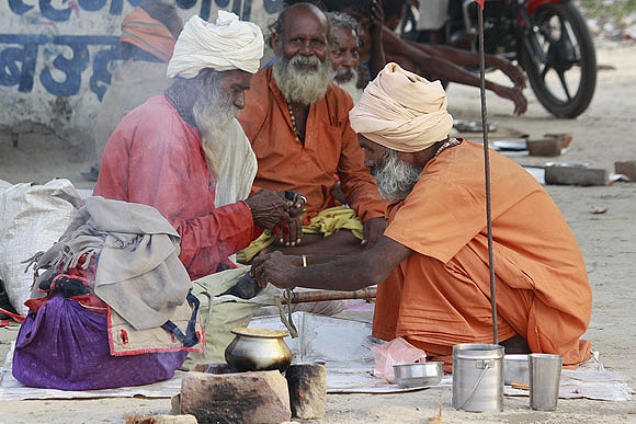Kanta Prasad (in red, centre) left his home in Madhya Pradesh to be a wandering sadhu
