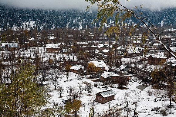 A view of the heavy first snowfall at the Baba Reshi shrine in Gulmarg