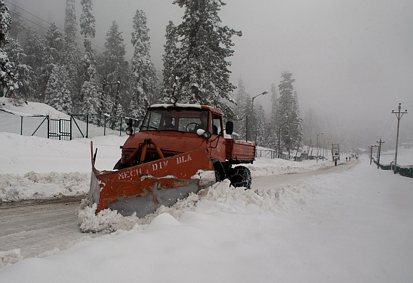A snow clearing machine in action after the heavy snowfall at Gulmarg