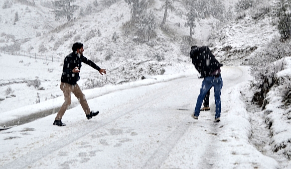 Youths playing with snowballs  near the Baba Reshi shrine