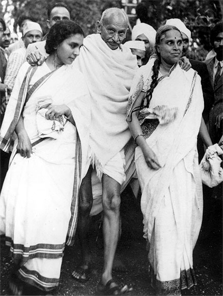 Indian nationalist leader Mahatma Gandhi (Mohandas Karamchand Gandhi) leaving Maor Ville, his Simla residence, during the Leaders Conference.  He is helped to his car by his doctor Sushelia Nayyer, right, and Susila Ben, left, and accompanied by his private secretary Mr Piare Lal.