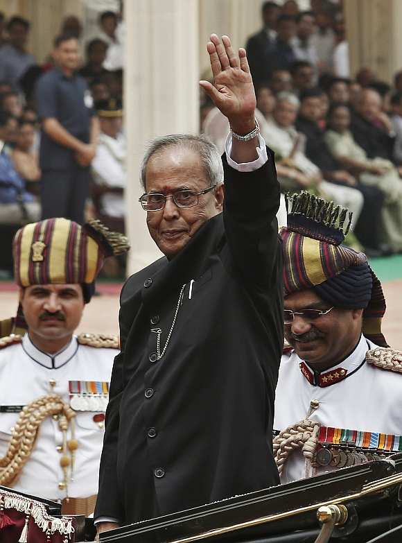 President Pranab Mukherjee waves from a horse carriage after his swearing-in ceremony, at Rashtrapati Bhavan in New Delhi