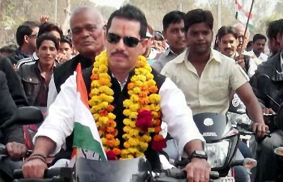Robert Vadra, a bike aficionado, opts for a commuter bike as he steps out to campaign for the Congress party.