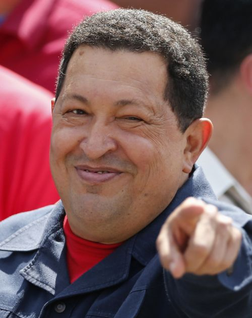 Hugo Chavez gestures to supporters after casting his vote during the presidential elections in Caracas on Sunday