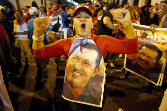 Supporters of Hugo Chavez gather outside Miraflores Palace to wait for the results of presidential elections in Caracas