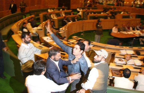 Marshals dragging three protesting youth from J&K assembly on Monday