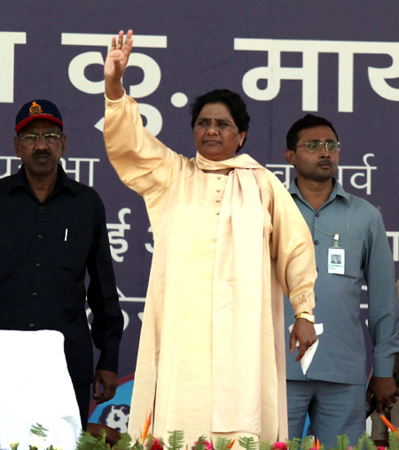 Mayawati waves to her supporters during the rally at Lucknow