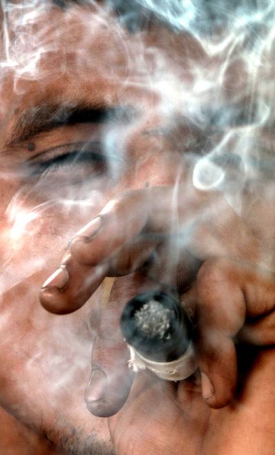 A youth smokes marijuana