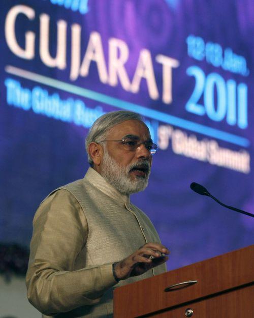 Modi speaks during the Vibrant Gujarat Global Investors' Summit 2011 at Gandhinagar