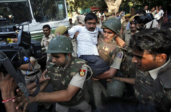 Activist Arvind Kejriwal being detained by the Delhi police