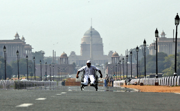 A man in a wheelchair makes his way to join protesters near Rashtrapati Bhavan in New Delhi