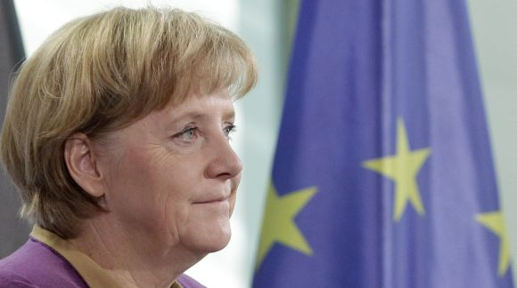 German Chancellor Merkel pauses during statement to media in Berlin on Friday