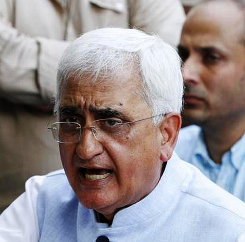 Law Minister Salman Khurshid reacts at the press conference in New Delhi