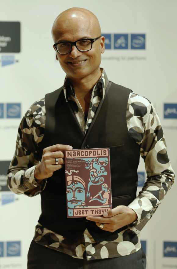 Jeet Thayil of India, one of the shortlisted authors for the 2012 Man Booker Prize, poses with his book 'Narcopolis', in London