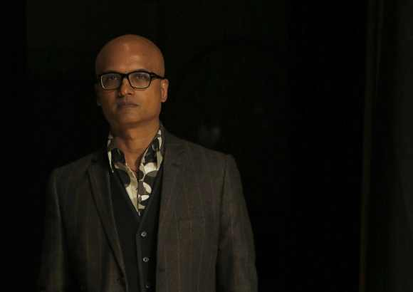 Jeet Thayil of India, one of the shortlisted authors for the 2012 Man Booker Prize, poses for photographers in London