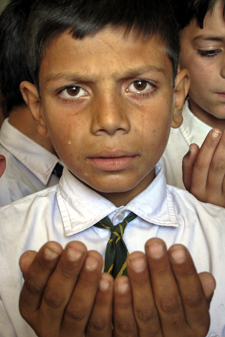 A boy cries as he prays for the speedy recovery of Pakistani schoolgirl Malala Yousufzai.