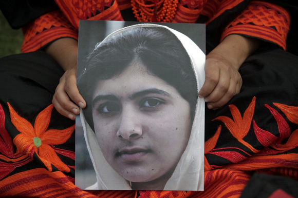 Pak raises its hands in prayer for young activist Malala